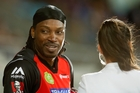 Chris Gayle chats up Mel McLaughlin. Photo / Getty Images