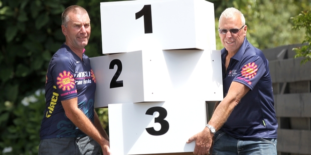 Summer Cycling Carnival race director Ivan Aplin (right) and Ramblers Cycling Club member with traffic management supervisor Tony Hartley, pictured getting the winner and placegetter podiums ready for the opening events. Photo / Duncan Brown