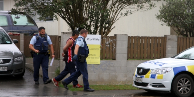 ONE MORE: Police lead the Kaitaia man arrested on Friday to a patrol car.