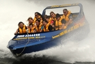 Tourists thrill to a Whanganui River jetboat trip.