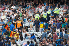 Police escort some Sri Lankan fans from the East Stand at Eden Park. Photo / Jason Oxenham