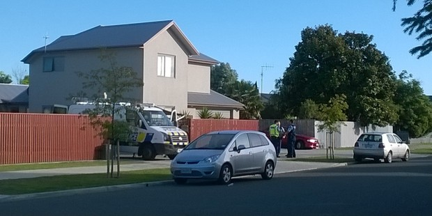 Police said they were working to try and get a man down from a roof. Photo / Duncan Brown