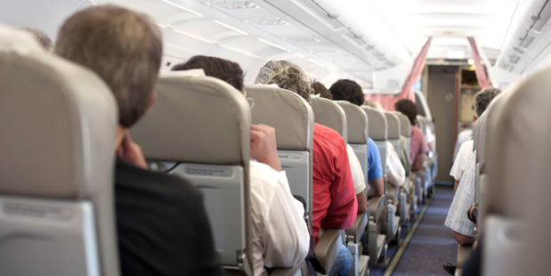 Cabin crew, assisted by willing passengers, restrained the intoxicated defendant by placing handcuffs on him. Photo / iStock
