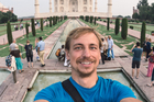 A tourist takes a selfie in front of the Taj Mahal. Photo / iStock