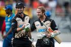 Black Cap batsmen Colin Munro and Kane Williamson leave the field after winning the Twenty20 international against Sri Lanka at Eden Park. Photo / Jason Oxenham