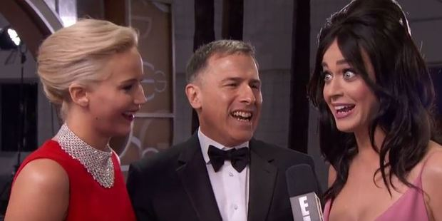 Jennifer Lawrence, Joy director David O. Russell and Katy Perry on the Golden Globes red carpet.