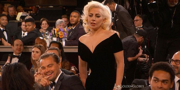 Lady Gaga didn't look impressed with Leonardo DiCaprio's behaviour. Photo / ABC