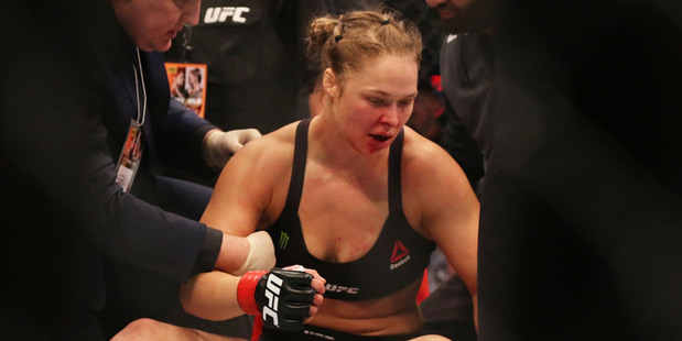 Loading Ronda Rousey after being knocked out by Holly Holm. Photo /Getty