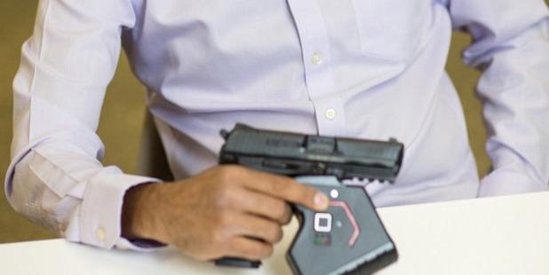 Omer Kiyani holds his smart technology lock for firearms. Photo / Omer Kiyani