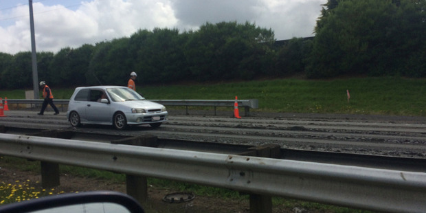 Human waste spilled onto the Auckland motorway. Photo / Supplied by Amber Neale