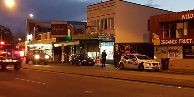 Police outside the Cameron Rd dairy which was robbed at 5.26pm this evening.