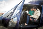 Sarah Harvey with her son Mason Knight on a police helicopter at the Mechanics Bay base yesterday. Photo / Jason Oxenham