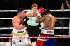 Joseph Parker fights Solomon Haumono as referee Bruce McTavish looks on. Photo / photosport.nz
