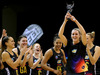 Leana de Bruin of the Magic lifts the NZ conference trophy. Photo / Michael Bradley Photography