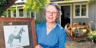 SLICE OF HISTORY: Ann Bary with  a photo of horse Sasanof and the three-handled, three-legged 1916 Melbourne Cup. PHOTO/FILE