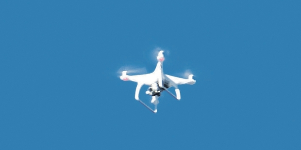 PUZZLING: Confusion has arisen over the legality of drone use in suburban areas, after this drone was spotted flying over Waipukurau recently. PHOTO/FILE