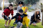Pokemon hunters Andre Johnson (left), Louis Cook, Tommy Kaiwai and Liam Kaiwai set off after discovering Pikachu aka Tom Worthington, during the Northtech Pokemon hunt at the Whangarei Town Basin yesterday. Photo / John Stone