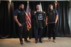 Charlie Faumuina and Jerome Kaino present an All Blacks jersey to  Joe Biden. Photo / Fairfax Pool