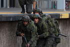 Soldiers take part in a security training drill simulating a terrorist attack at the Deodoro train station ahead of the Olympic games in Rio de Janeiro, Brazil. Photo / AP