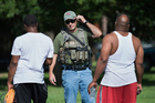 A US Marshall talks to people as authorities investigate an area in Kansas City, Missouri, in relation to the Baton Rouge shootings. Photo / AP