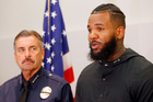 Los Angeles Police Chief Charlie Beck, left, listens as rapper The Game speaks at a news conference. Photo/AP