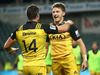 Beauden Barrett of the Hurricanes celebrates scoring a try with team mate Cory Jane during the round 16 Super Rugby match between the Waratahs and the Hurricanes. Photo / Getty Images.