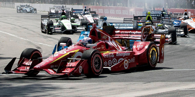 Scott Dixon leads the pack as drivers take the first corner at the IndyCar Toronto. Photo / AP