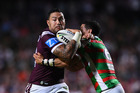 Feleti Mateo is tackled during a game against the South Sydney Rabbitohs. Photo / Getty Images