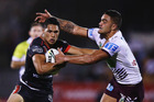 Roger Tuivasa-Sheck fends off Dylan Walker of the Sea Eagles. Photo / Getty Images