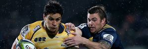 Matt Toomua of the Brumbies and Liam Squire of the Highlanders. Photo / Getty