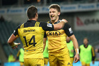Beauden Barrett of the Hurricanes celebrates scoring a try with team mate Cory Jane. Photo / Getty