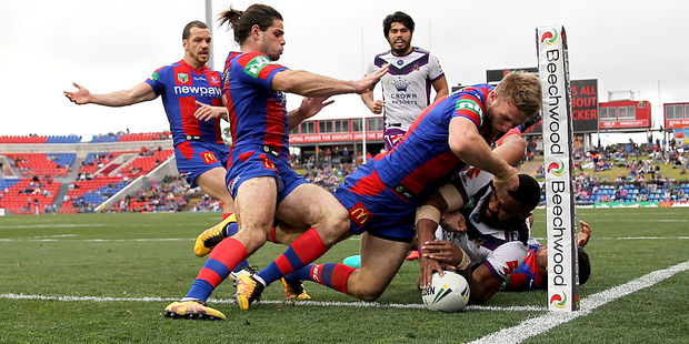 Marika Koroibete of the Storm scores a try during the round 19 NRL match between the Newcastle Knights and the Melbourne Storm. Photo / Getty