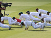 Younis Khan leads the Pakistan team as they perform press ups to celebrate winning a test match against England. Photo / Getty