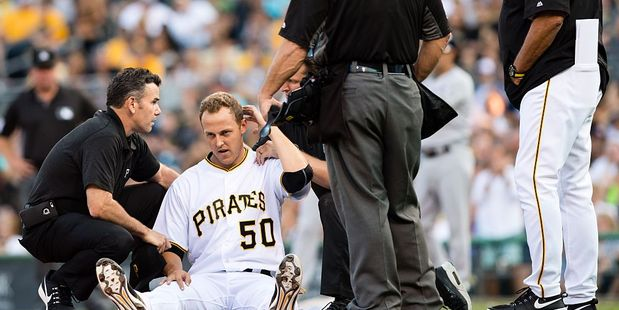 Jameson Taillon is looked at by a trainer after being struck in the head. Photo / Getty Images
