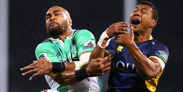 Patrick Osborne of the Highlanders and Aidan Toua of the Brumbies both miss the ball. Photo / Getty