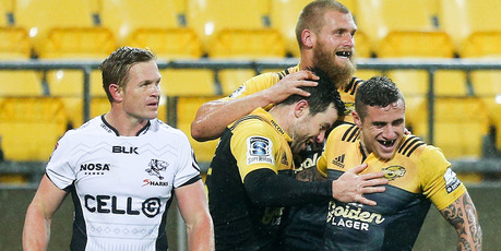 The Hurricanes celebrate James Marshall's try in their big win over the Sharks. Photo / Getty