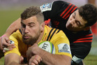 Callum Gibbins of the Hurricanes dives over to score a try during the round 17 Super Rugby match between the Crusaders and the Hurricanes. Photo / Getty Images.