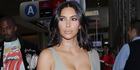 """Kim Kardashian West enlisted the service of a """"small police force"""" to surround her as she attended a Hamptons house party for a fashion label. Photo / Getty"""