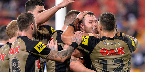 Trent Merrin of the Panthers is congratulated by team mates after scoring a try during the round 20 NRL match between the Brisbane Broncos and the Penrith Panthers. Photo / Getty Images.