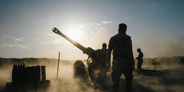 Iraqi soldiers fire artillery towards Islamic State positions from a location outside Makhmour, Iraq. Photo / Washington Post