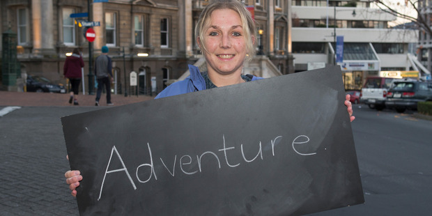 Sally Upsher, 33, of Mosgiel, in Dunedin with her chalkboard message on what it means to be a New Zealander. Photo / Mark Mitchell