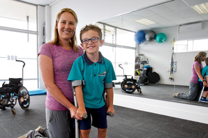 DETERMINED: Austin Manning, with his physiotherapist Amanda Meys, at Avenues Physio-Fitness where he has been strengthening his limbs for his operation. Photo/Ruth Keber