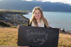 Vanessa Chambers, 37, of Kaikoura, with her chalkboard message on what it means to be a New Zealander. (Who We Are) 10 June 2016 New Zealand Herald Photograph by Mark Mitchell.