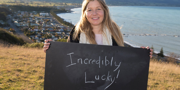 Vanessa Chambers, 37, of Kaikoura, with her chalkboard message on what it means to be a New Zealander. Photo / Mark Mitchell