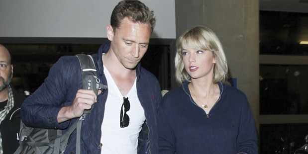 Tom Hiddleston and Taylor Swift look very happy together according to Chris Hemsworth. Photo / Snapper Media