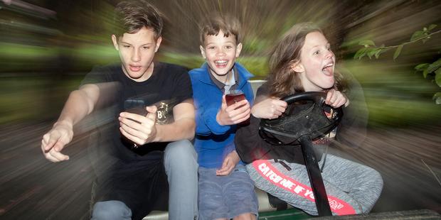 Loading Ben, 14, Rory, 11, and Phoebe Robertson, 14, searching for Pokemon in Katikati Bird Gardens. Photo/Andrew Warner