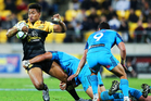 Hurricanes' Julian Savea is tackled during the round 15 Super Rugby match. Photo / www.photosport.nz