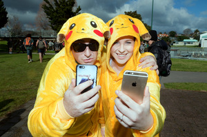 Bethlehem woman Renee Pink (right) and her fiance Justin Evans dressed up as Pikachu to take part in the 10km PokeWalk.
