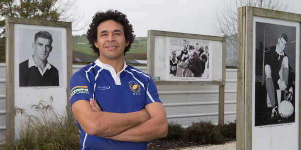 Waitete Rugby Football Club player Alan Ford, 39, among the life-size images of Colin Meads at the club in Te Kuiti. Photo / Mark Mitchell