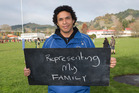 Alan Ford, 39 in Te Kuiti with a chalkboard message on what it means to be a New Zealander. Photo / Mark Mitchell